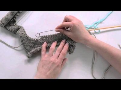 12 Riprendere le maglie su una scollatura