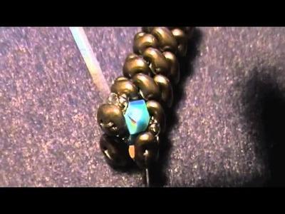 Inserire bicono swarovski in spirale con superduo
