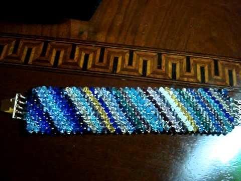 Bracciale capricho e ciondolo triangolo brick stitch capriccio