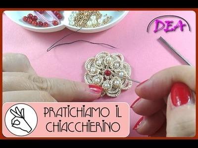 P.I.C.T.3°aP.2° - La perla al centro della rosetta  e la raggiera delle perline dorate.