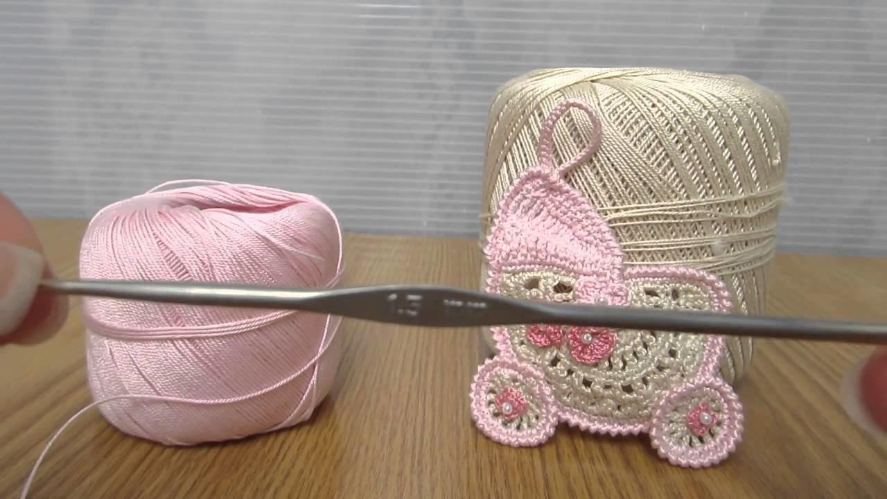 Confettata ciondolo carrozzina bimbi, realizzata a uncinetto con filati in cotone.