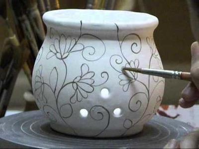 Decorazione di un portaglio in ceramica