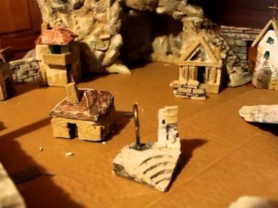Creare e pitturare montagne e muri del presepe