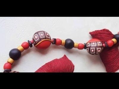 Perle a quadri con lunetta rossa (tutorial con murrina a quadri concentrici)