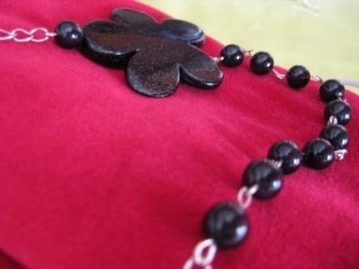 Collana fiore nero (catena + chiodini)